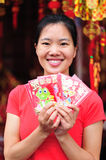 Happy asian woman with red packs Royalty Free Stock Photo