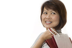 Happy Asian woman with shopping bags Stock Photo