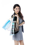Happy Asian woman with shopping bags Stock Image