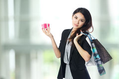 Happy Asian woman with shopping bags Stock Images