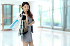 Happy Asian woman with shopping bags Royalty Free Stock Images