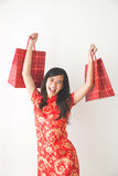 Happy asian woman shopping on chinese new year celebration. Portrait of happy excited asian woman shopping on chinese new year celebration Stock Images