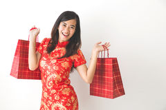 Happy asian woman shopping on chinese new year celebration. Portrait of happy excited asian woman shopping on chinese new year celebration Royalty Free Stock Photo