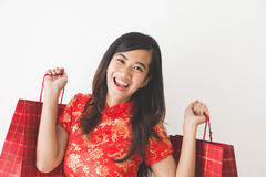 Happy asian woman shopping on chinese new year celebration. Portrait of happy excited asian woman shopping on chinese new year celebration Stock Photo