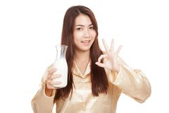 Happy Asian woman show OK drink milk in morning Royalty Free Stock Photo