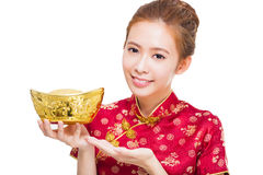 Happy asian woman showing gold for chinese new year. Isolated on white background