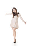 Happy Asian woman with slender legs Stock Photography