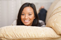 Happy asian woman on the sofa Stock Photography