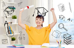 Happy asian woman student with diploma at home. People, education, school, graduation and learning concept - happy asian young woman student with diploma scroll Royalty Free Stock Photos