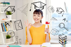 Happy asian woman student with diploma at home. People, education, school, graduation and learning concept - happy asian young woman student with diploma scroll Stock Photos