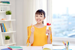 Happy asian woman student with diploma at home Stock Images