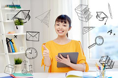Happy asian woman student with tablet pc at home. People, education, high school and learning concept - happy asian young woman student with tablet pc computer Stock Photos