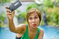 Happy Asian woman taking selfie picture for social media interne Royalty Free Stock Photo