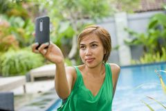 Happy Asian woman taking selfie picture for social media interne Stock Image