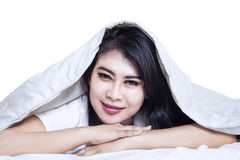 Happy asian woman under the blanket Stock Photo