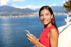 Free Happy Asian Woman Using Phone App In Vancouver City Harbour On Summer Day. Beautiful Landscape Of Canadian Nature River Stock Image - 172552581