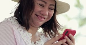 Happy asian woman using smart cell phone in cafe. stock video