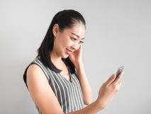 Happy woman using smartphone. stock image