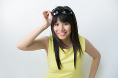 Happy Asian woman wearing bright yellow outfit Stock Photos