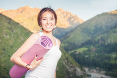 Happy asian woman with yoga mat going to fitness exercises Royalty Free Stock Photo