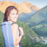 Happy asian woman with yoga mat going to fitness exercises Stock Photography