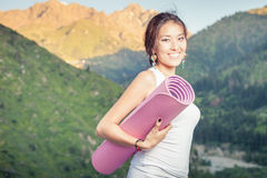 Happy asian woman with yoga mat going to fitness exercises Royalty Free Stock Images