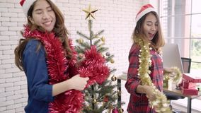 Happy Asian women celebrate christmas party with friends in her office. Female celebrating New Year and Christmas Festival. Happy Asian women celebrate stock footage