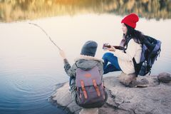 Happy Asian women playing guitar in nature winter season. Relax time on holiday concept travel partnership,selective and soft focus,tone of hipster style Royalty Free Stock Photos
