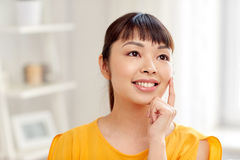 Happy asian young dreaming woman face at home Stock Photo