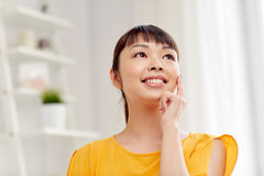 Happy asian young dreaming woman face at home Royalty Free Stock Images