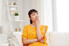 Happy asian young dreaming woman at home Royalty Free Stock Photo