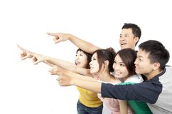 Happy Asian young group. Pointing away isolated on white background Stock Photography