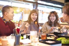 Happy young Group eating in the restaurant stock photos