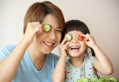 Happy Asian Young Mother and little girl having fun. royalty free stock images