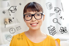 Happy asian young woman in glasses at home. People, education and school concept - happy asian young woman or teenage student girl in glasses at home with Stock Photography