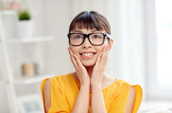 Happy asian young woman in glasses at home Royalty Free Stock Image