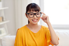 Happy asian young woman in glasses at home Royalty Free Stock Photography