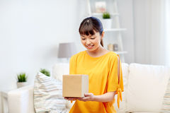 Happy asian young woman with parcel box at home Royalty Free Stock Photos