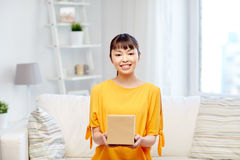 Happy asian young woman with parcel box at home Stock Images
