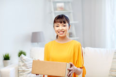 Happy asian young woman with parcel box at home Royalty Free Stock Photography