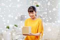 Happy asian young woman with parcel box at home Stock Photography