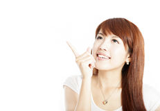 Happy asian  young  woman pointing Stock Image