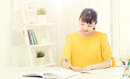 Happy asian young woman student learning at home Stock Photography