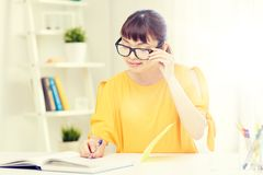Happy asian young woman student learning at home Stock Image