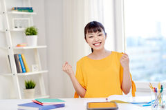 Happy asian young woman student learning at home Royalty Free Stock Images