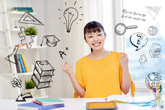 Happy asian young woman student learning at home. People, education, success and learning concept - happy asian young woman student with tablet pc computer, book Stock Image