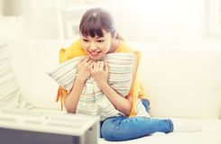 Happy asian young woman watching tv at home. Television, entertainment, leisure and people concept - happy asian young woman watching tv at home Royalty Free Stock Photo