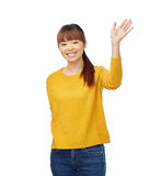 Happy asian young woman waving hand over white. People, race, ethnicity and gesture concept - happy smiling asian young woman waving hand over white Royalty Free Stock Photos