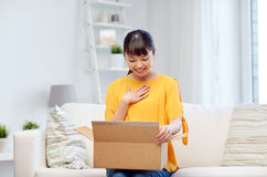 Free Happy Asian Young Woman With Parcel Box At Home Stock Photo - 68747060