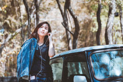 Happy asian youth teenage using and listening music on cellphone Royalty Free Stock Photography